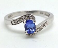 Tanzanite Heating Solitaire with Accents Fine Rings
