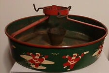 Vintage Metal Christmas Tree Stand with Santas dancing around red green display