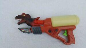 Vintage Dnosaur Swing water Gun Toy
