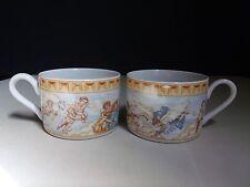 (2) 1994 Fitz and Floyd Habitat Americana Ominibus Cherub Angel Flat Coffee Cups