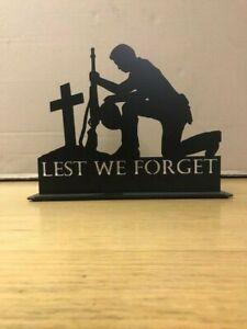 Lest We Forget kneeling soldier tea light