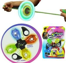 LIGHT UP PULL STRING WHIRLIGIG SPINNING TOPS toy lighting new .................