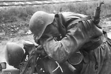 WW2 Photo WWII German Soldier Rests on Motorcycle World War Two Wehrmacht / 2471