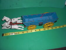 CAST IRON WHITE HORSES AND BLUE  WAGON  Cast iron covered wagon with horses