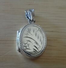Sterling Silver 29x14x6mm Oval 2 Picture Photo Locket Charm with Bale