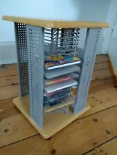 Wood and metal cd holder. Holds 100 CDs. Swivel turntable. Great quality.