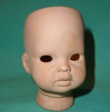 bisque head by Helga Matejka artists reproduction, to tie in