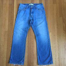 Levi's Men's 557 Relaxed Bootcut Medium Wash Denim Jeans 33 X 32