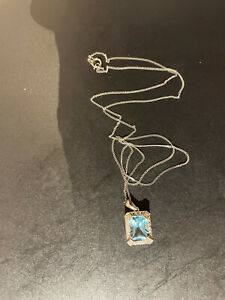 Blue Topaz and Diamond Pendant 9K White Gold Setting and Fine Chain Ernest Jones