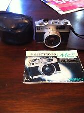 YASHICA  ELECTRO 35 MC 40mm CAMERA WITH BOOK AND BAG-NICE CONDITION