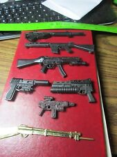 Seven Different Action Figure Weapons - 2-1/4 to 5-1/2 inches Long
