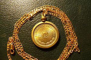 "Golden Brass SOL, SUN, Coin Bezel Pendant on a 28"" Gold Filled Figaro Chain"