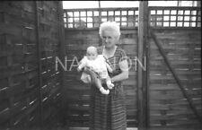 2 Original photo negatives - GRANDMOTHER & baby/boy standing alone in back yard