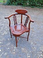 Chinese rosewood corner chair with intricate bird and floral detail
