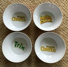 CEREAL BOWLS(4) General Mills. Two Honey Nut Cheerios. One Trix.One Lucky Charms
