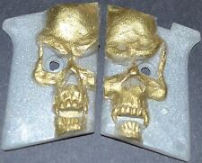 Phoenix Arms Raven 25ACP pistol grips gold skull on pearl white plastic