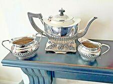 More details for vintage silver plated half ribbed tea service & trivet