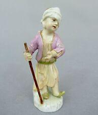 KPM Berlin Figur / Amorette, Bettler mit Stab, 19. Jahrhundert, Höhe ca. 8,5 cm
