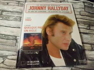 JOHNNY HALLYDAY LA COLLECTION OFFICIELLE 1982 QUELQUE PART UN AIGLE  CD + LIVRE