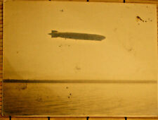 DIRIGIBLE/BLIMP/LIGHTER-THAN-AIR CRAFT OVER UNKNOWN LOCATION/PLANE ABOVE/PHOTO