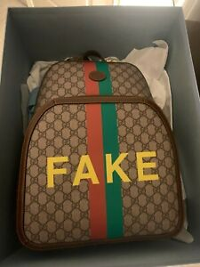 Gucci Fake/Not GG Supreme Canvas Backpack
