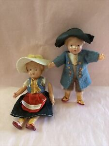 2 CELLULOID (?)DOLLS MADE IN JAPAN SOME DAMAGE Dutch? German? Great Outfits!
