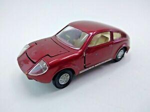 Corgi 341 Mini Marcos GT850 Removable wheels Golden Jacks