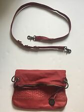 The SAK Distressed Red Leather Convertible Crossbody Clutch Purse