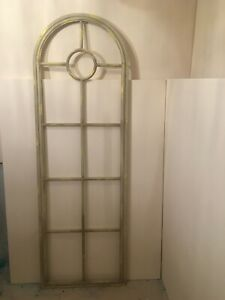 Rustic vintage rounded-arched metal window-type frame