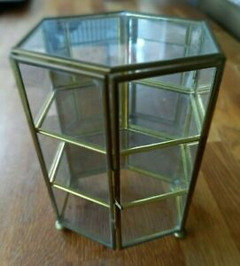 Small metal & glass display cabinet 2 hinged doors mirror back.