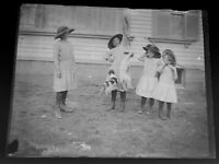 Vintage Glass Photo Negative of 4 girls making 2 Jack Russell Terriers ? Jump