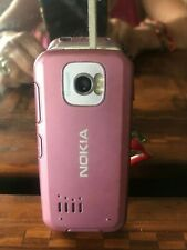 Vintage mobile nokia 7610s operating with charging cable