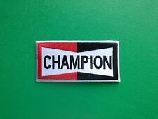 MOTOR RACING OILS, FUELS & TYRES SEW ON / IRON ON PATCH:- CHAMPION SPARK PLUGS