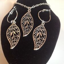 Leaf necklace and matching hoop earrings silver plated.