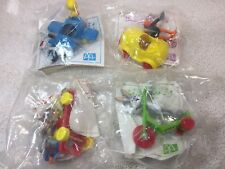 "Looney Tunes Toy Riders ""Complete Set Of Four""  NIP McDonald's Canada 1989"