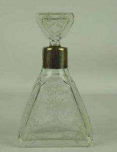 LIQUOR BOTTLE. GLASS OF BOHEMIA? CARVED BY HAND AND SILVER. YEARS 30-40