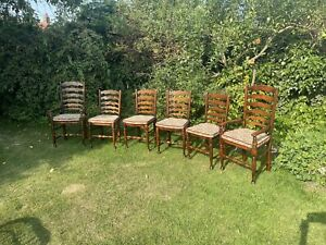 6 Antique ladderback rush seat dining chairs including carvers And Cushions