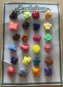 VINTAGE PLASTIC FIGURAL BUTTONS ON CARD LOT OF 24