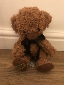 Merrythought Bear. Large Headed With Bow Around Neck And Bells In Ears.