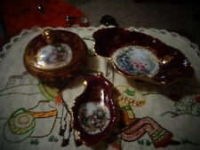 4 pieces red and gold limoges in excellent condition.
