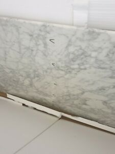 White marble top with an almost invisible crack in the middle without a base