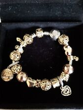 Pandora Bracelet with 18 pcs charms gold, two tone and rose gold + 3 charms