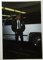 vintage PHOTO Man in Uniform Posing by White SUV with Blue ID Tag In Garage