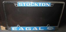 "Vintage License Plate Frame  ""Eagal"" Ford Stockton"