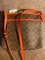 Coach Signature C Coated Canvas Crossbody Bag orange strap