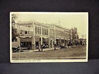 1900's ORD Nebraska North Side Square Cars Buildings People Dirt RPPC Postcard