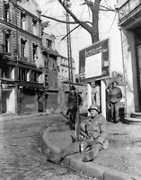 WWII photo American infantryman Coy Hines is resting on the street of Forbac 24n