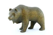 A skillfully hand carved wooden bear sculpture Signed FA