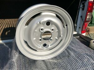 TUDOR WHEELS LTD Classic Vintage Wheel Restoration MG Midget Sprite Sebring Frog