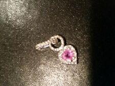 Pink sapphire and diamond pendant; 14K white gold
